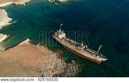 Aerial Drone View Of An Abandoned Ship Moored At The Coastal Rocky Area. Peyia Paphos Cyprus