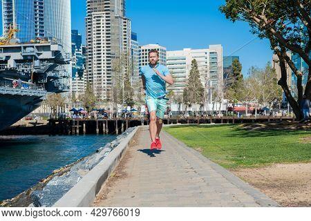 My Run My Speed. Energetic Man Run On Promenade. Male Runner In Sportswear. Running Exercises