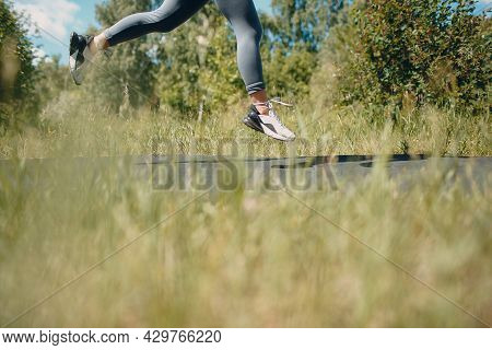 Runner Woman In Running Shoes Closeup Of Woman Sporty Legs. Female Jogging