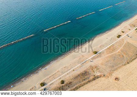 Aerial Drone Scenery Of The Coastline Seascape With Sandy Beautiful Beach. Polis Paphos Cyprus