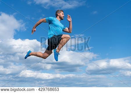 Energetic Man Athlete With Muscular Body Run In Sportswear Outdoor On Sky Background, Endurance