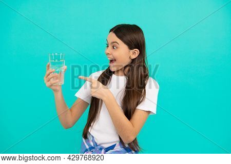 Hydration Vitality. Be Hydrated. Kid Hold Glass Of Mineral Water. Child Feel Thirsty.