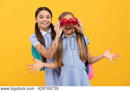 Happy Child Cover Classmates Eyes With Apples Yellow Background, Eye Health