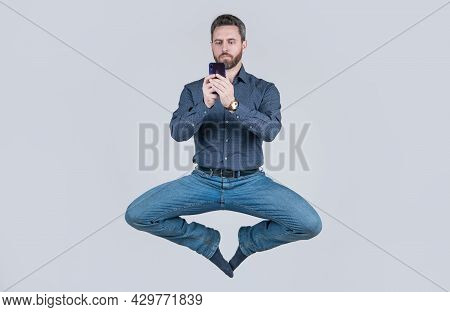 Jump Ceo Meditating Online. Sms And Instant Messaging. Yoga Energetic Businessman Chat Online.