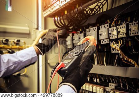 Electricity And Electrical Maintenance Service, Engineer Using Measuring Equipment Checking Electric