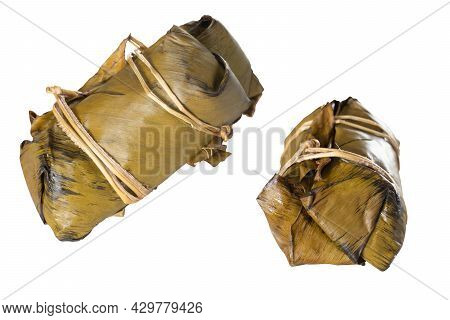 Two View Of Bananas With Sticky Rice Delicious Snacks From Thailand. Covered With Banana Leaves Tied