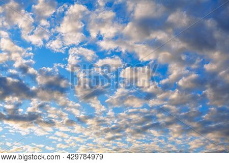 Clouds Like Patterns On The Blue Sky . Daytime Autumn Sky
