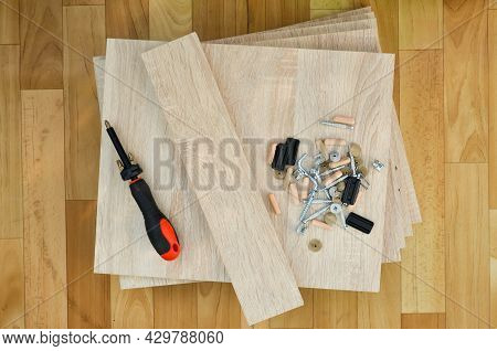 Chipboard Sheets, Tools And Parts For Assembly Of Cabinet Furniture. Self-assembly Of Furniture At H