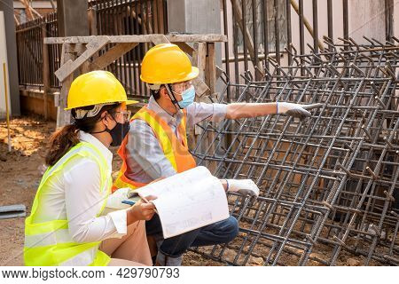 A Team Of Man And Female Engineers Or Architects Is Exploring And Inspecting The Outdoor Constructio
