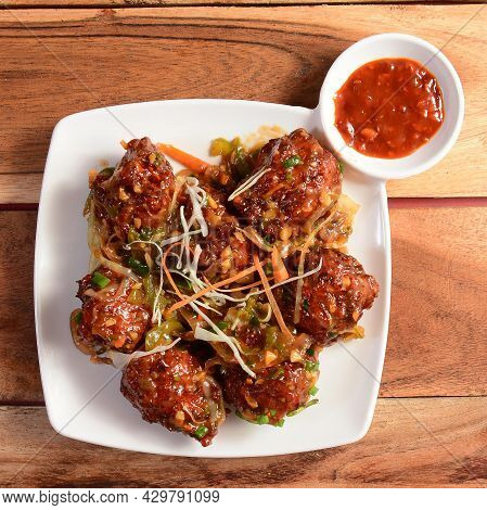 Assorted Indian Food Honey Chilli Chicken On Wooden Background. Dishes And Appetizers Of Indian Cuis
