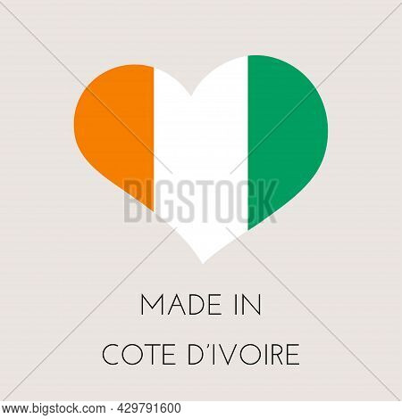 Heart Shaped Label With Ivory Coast Flag. Made In Cote D'ivoire Sticker. Factory, Manufacturing And