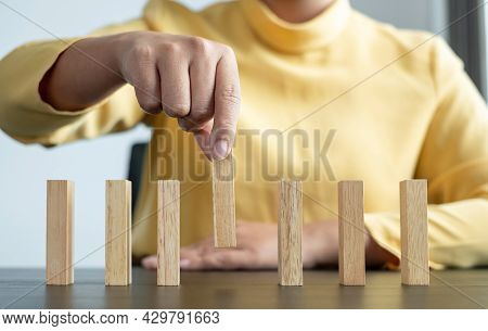 Hands Of Businesswomen Playing Wooden Block Game. Concept Risk Of Management And Strategy Plans For
