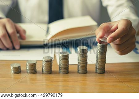 Man's Hand. Place A Coin On The Coin Graph With Coins, Saving Money With Coins, Stepping Into A Succ