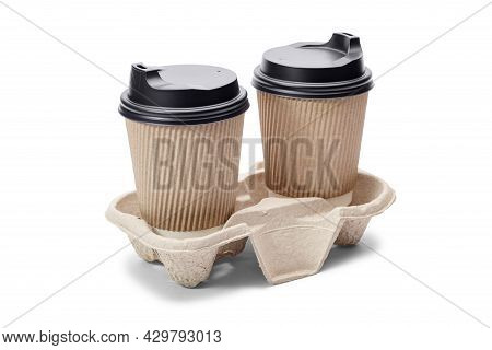 Disposable Paper Coffee Cups With Black Caps On Cardboard Stand Isolated On White Background. Takeaw