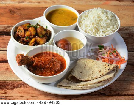 Indian Non-veg Thali / Food Platter Consists Variety Of Veggies,chicken Meat, Lentils, Sweet Dish, S