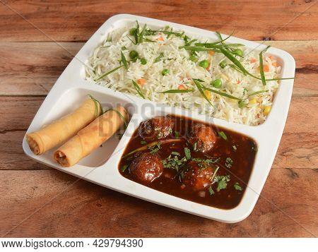 Indo Chinese Veg Combo Meal - Consists Of Veg Pulav, Veg Manchurian And Spring Rolls. Selective Focu