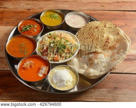 Veg Thali From An Indian Cuisine, Food Platter Consists Variety Of Veggies,soup,paneer Dish, Lentils