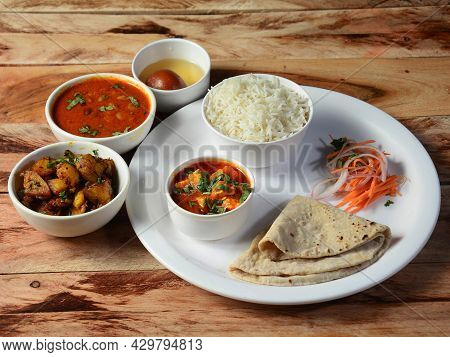 Veg Thali From An Indian Cuisine, Food Platter Consists Variety Of Veggies,paneer Dish, Lentils,rice