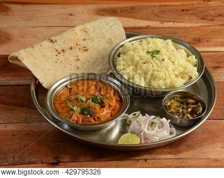 Veg Thali From An Indian Cuisine, Food Platter Consists Variety Of Veggies, Jeera Rice, Roti, Dal Ma