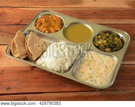 Veg Thali From An Indian Cuisine, Food Platter Consists Variety Of Veggies, Lentils,rice,roti Etc.,