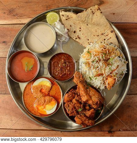 Chicken Thali From An Indian Cuisine, Food Platter Consists Chicken Fry,boiled Egg Curry, Lentils, C