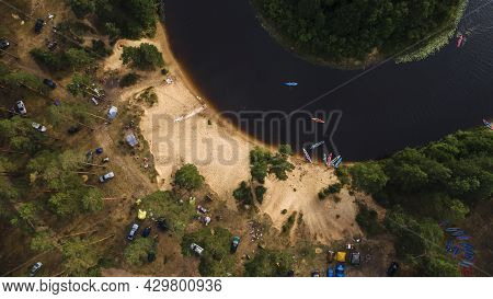 Kayaks On The River Bank. Tourist Kayaking Pier. Tourist Camp, River Pleasure Boat Pier During A Tou