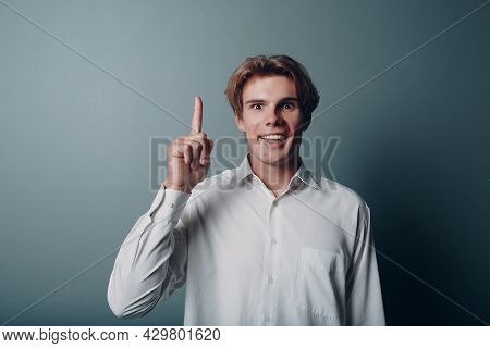 Young Man Pointing And Forefinger Index Finger Up