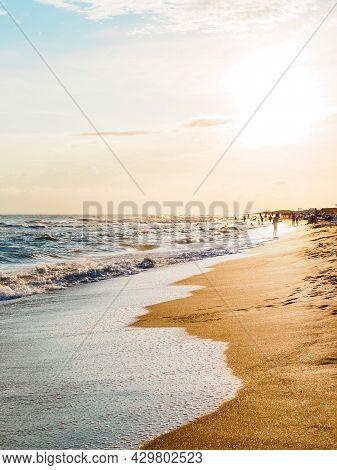 Sandy Seashore, Foamy Waves At Sunset - Beautiful Landscape