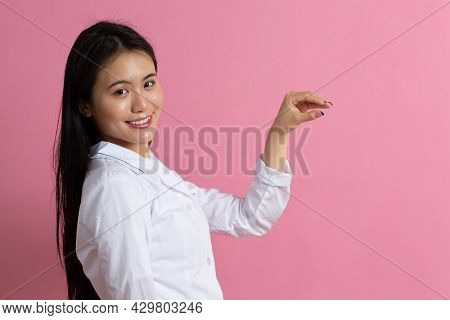 Asian Doctor Woman In White Medical Gown Hold Empty Space By Her Hand Template For Any Stuff Against