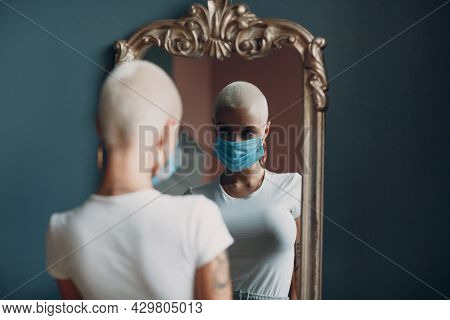 Millenial Young Woman In Medical Protective Face Mask With Short Blonde Hair Portrait Standing At Mi