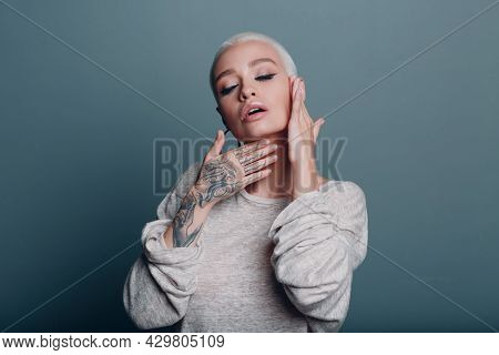 Millenial Young Woman With Short Blonde Hair Portrait Doing Face Yoga Self Facebuilding Massage For