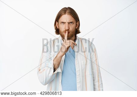 Shut Mouth. Angry Blond Bearded Man Frowning, Shushing, Making Hush Taboo Sign, Press Finger On Mout