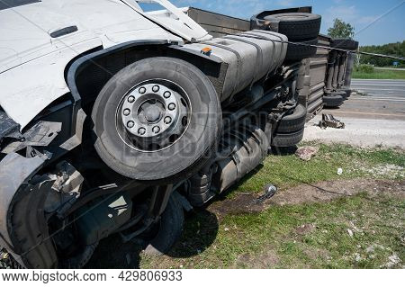 The Truck Is Lying On Its Side In A Car Accident On The Highway