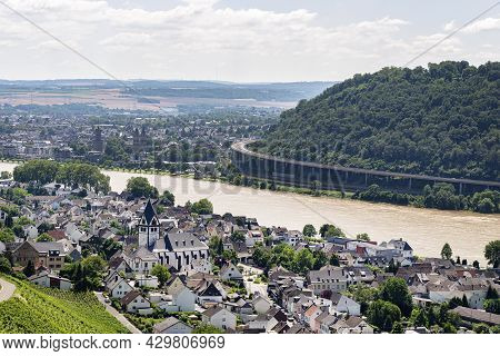 The River Rhine Flows Between The Village And The Forest Covered Hills Along Which There Is A Road C
