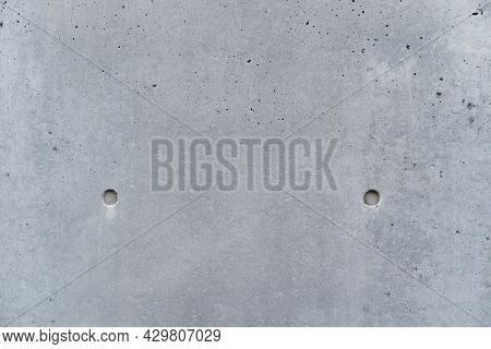 Smooth Bare Concrete Wall With Concrete Form Dimples. Concrete Texture Background Close Up View.