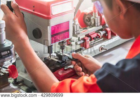 Blur Locksmith In Workshop Makes New Key. Professional Making Key In Locksmith. Machine Production O
