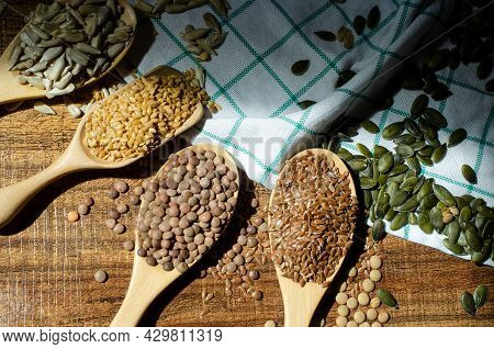 Four Kinds Of Natural Cereal And Grain Seed In Wooden Spoon Consisted Of Pumpkin Seed, Flax Seed, An