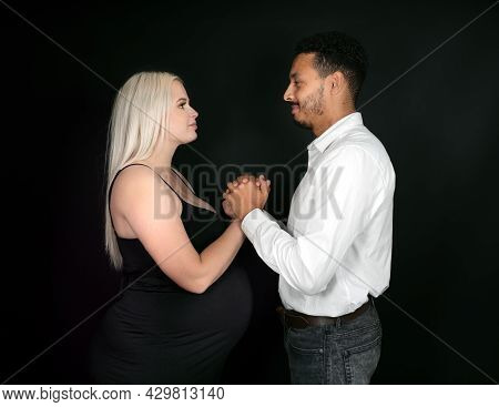 Profile View Of A Stylish And Happy Multi-ethnic Couple Expecting A Baby