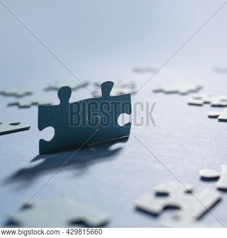 An Ideal Couple, Two Elements From A Large Puzzle Joined Together,
