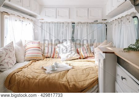 Bedroom Interior, Room Inside Of Motor Home. Bed With Colorful Pillows, Comfort House Design With Bl