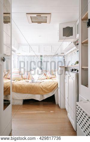 Design Of Modern Home, Open Door To White Bedroom. Decor Inside House, Camper Van Home Interior. Fur