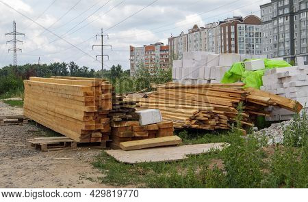 Stack Of Many Wooden Planks On A Construction Site, Building Material Background. Renovation, Roof O