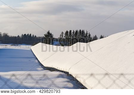 Solar Panel Field Covered With Snow. Renewable Energy In Winter Low Efficiency. Renewable Green Ener