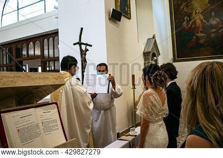 Nitra, Slovakia - 07.12.2021: Catholic Wedding Amid The Coronavirus Pandemic. People In Medical Mask