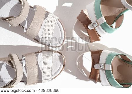 Beige Shades Famale Shoes And Girl's Shoes, Togetherness Concept. Mother And Daughter Family Relatio