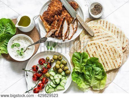 Ingredients For Cooking Greek Gyros - Chicken Schnitzel, Lettuce, Grilled Tortillas, Greek Yogurt Tz