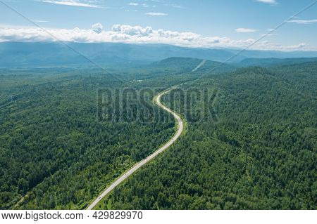 Aerial View Of The Road Of Lake Baikal. A Road Passing Through A Coniferous Forest, Aerial Photograp