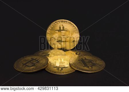 Bitcoin Btc Crypto Currency Gold Coins On Black Background, New Virtual Money Concept. Mining Or Blo