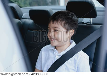 Cinematic Portrait Boy Siting In Safety Car Seat Looking Out With Smiling Face,child Sitting In The