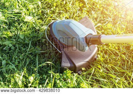 Cut The Lawn. Mowing Lawns. Lawn Mower On Green Grass. Cordless Mower Grass Equipment. Garden Care W